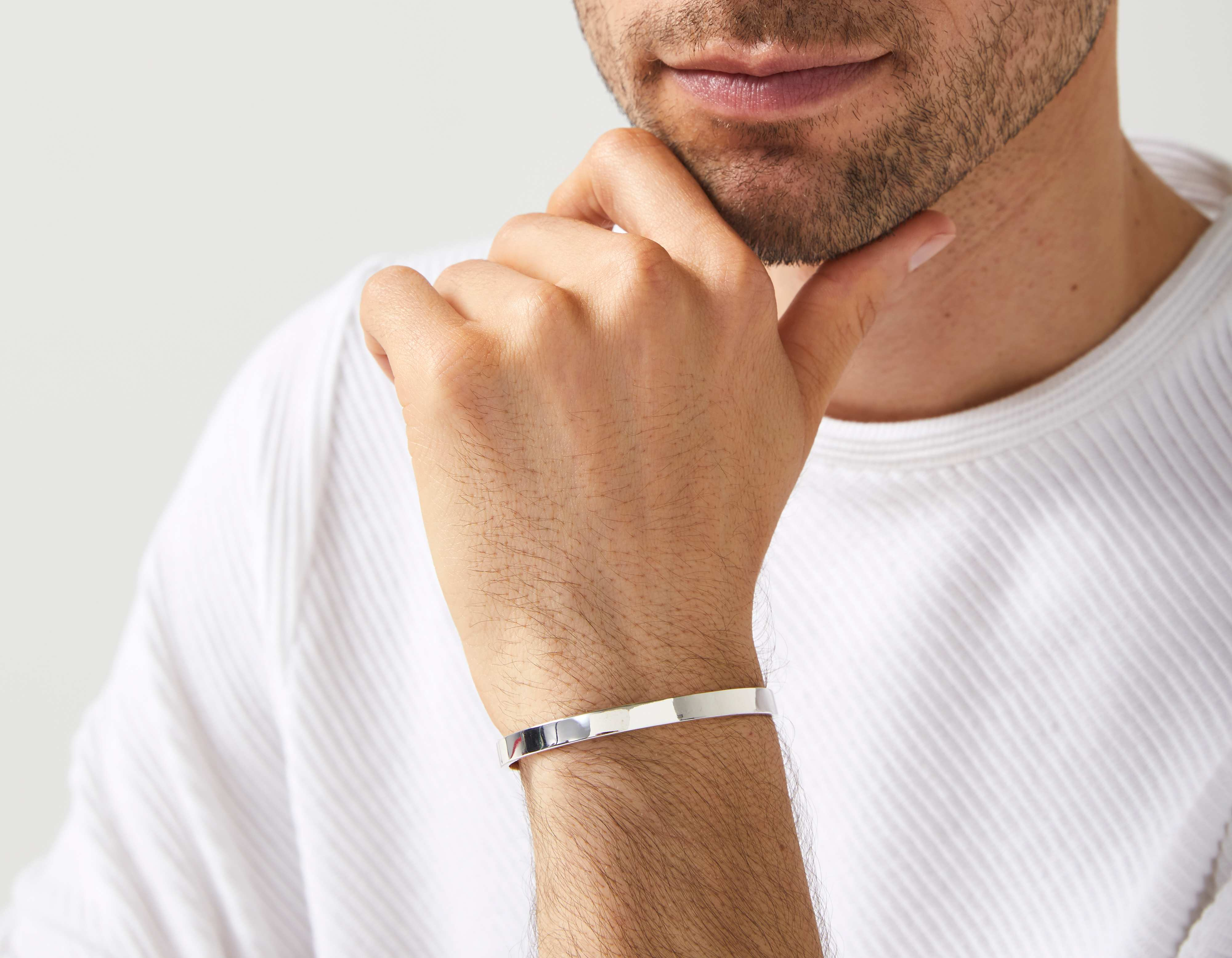 The Inner Wave Bracelet in Antiqued Sterling Silver on a male