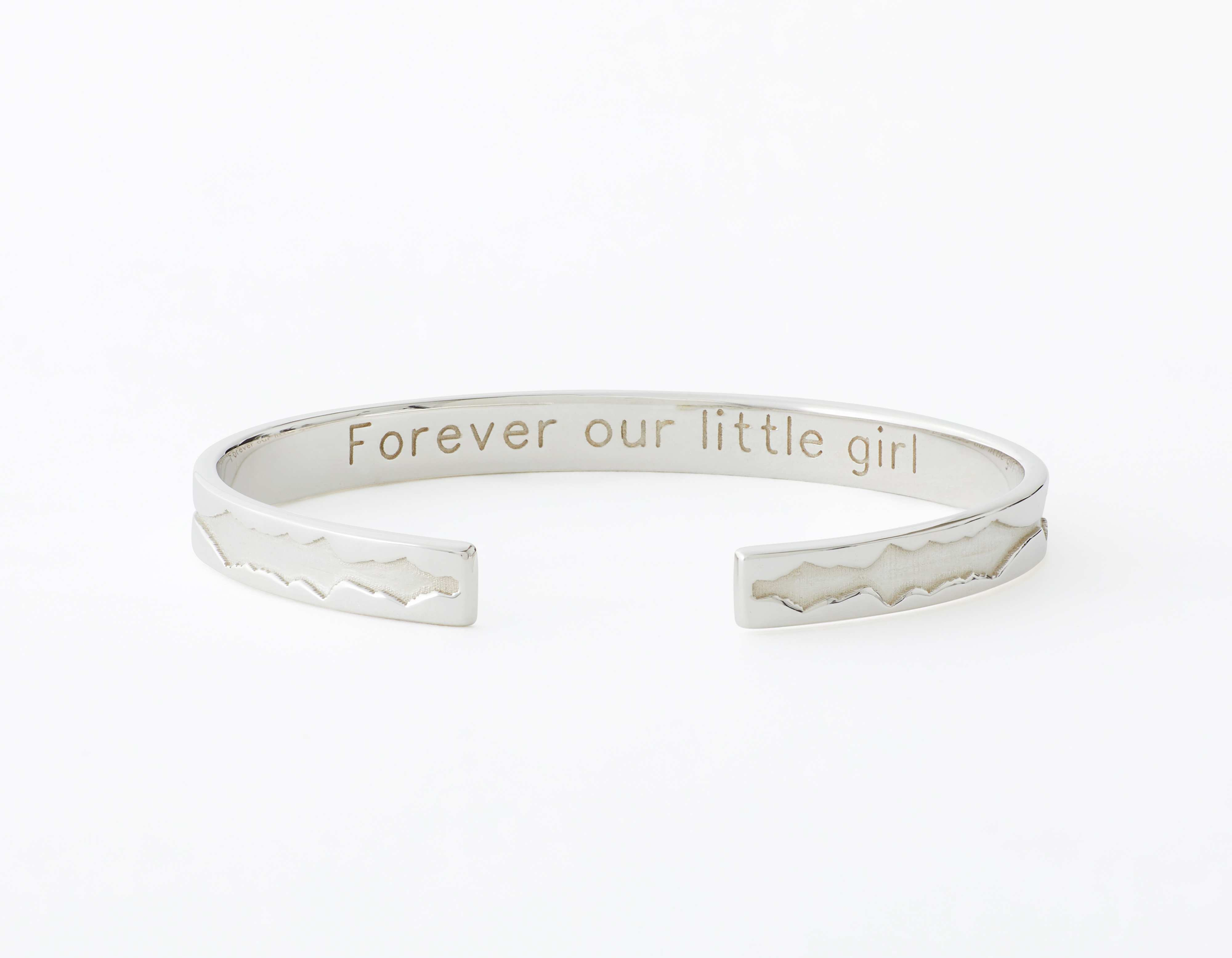 The Outer Wave Bracelet placed horizontal-inner in White Gold