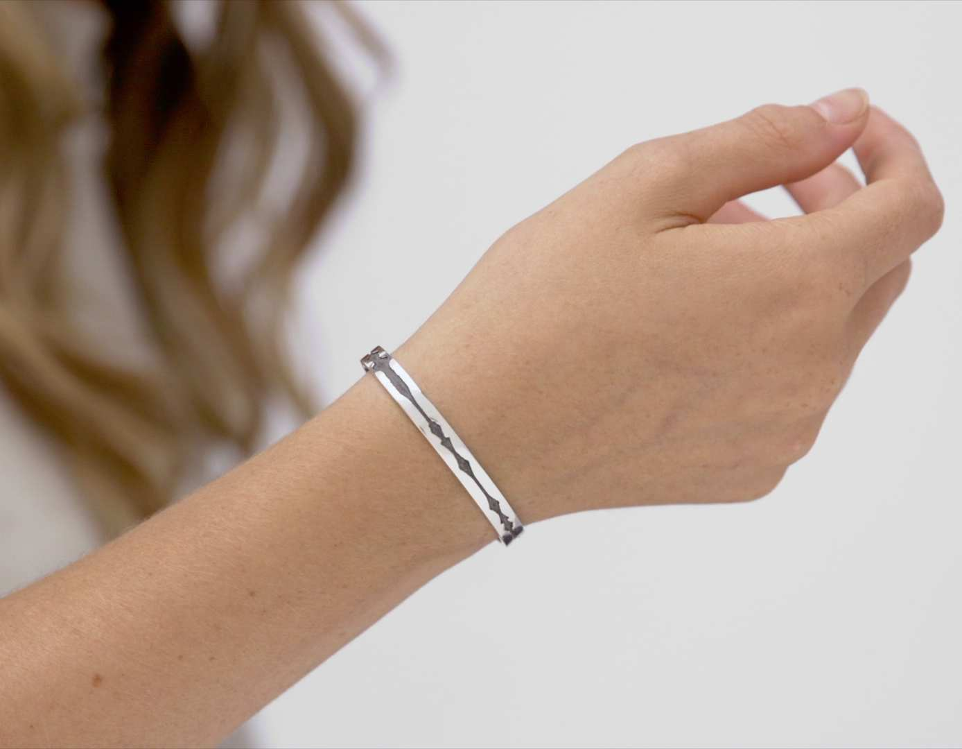 Video of The Outer Wave Bracelet in Antiqued Sterling Silver on a female thumbnail