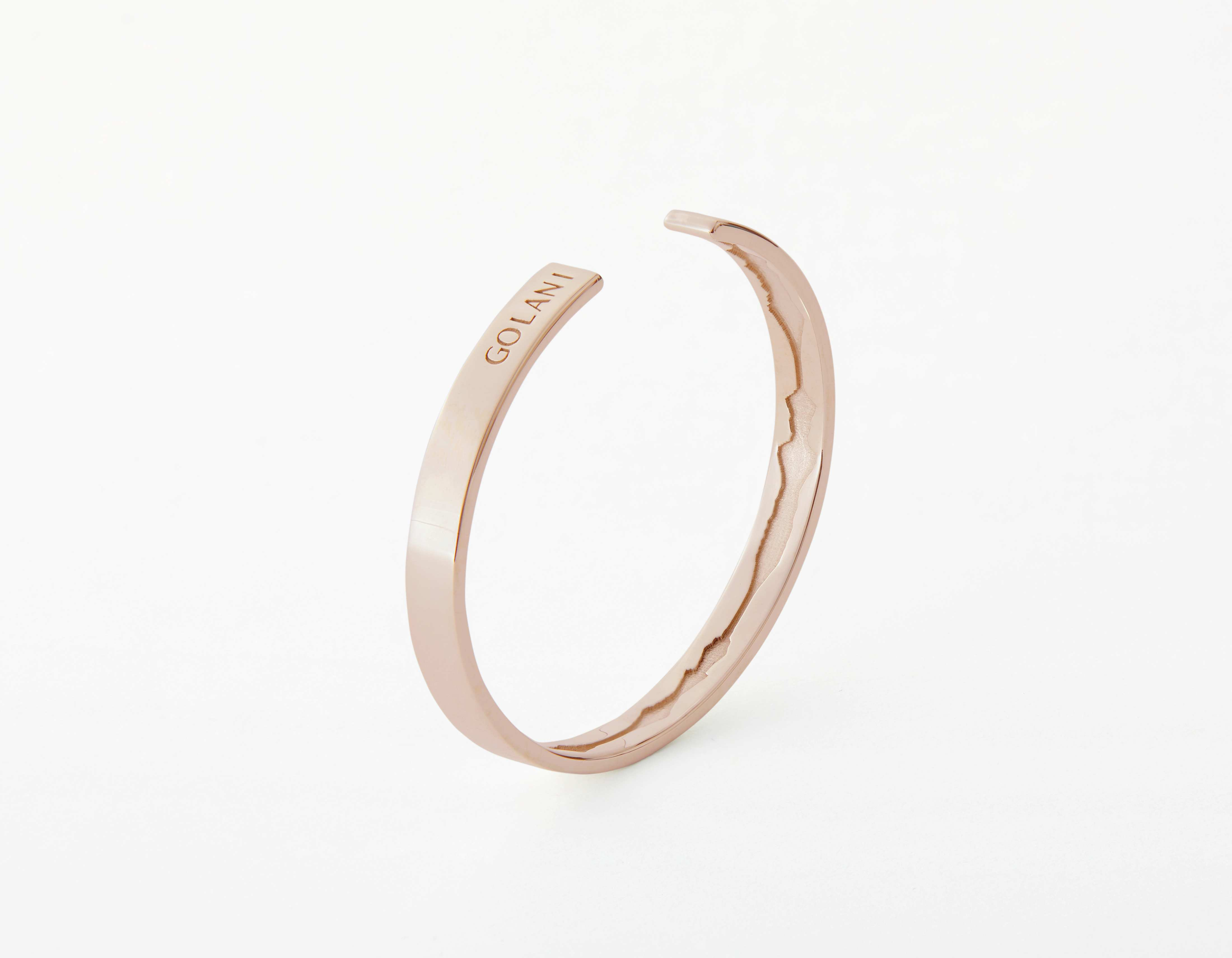 The Inner Wave Bracelet placed vertical in Rose Gold thumbnail