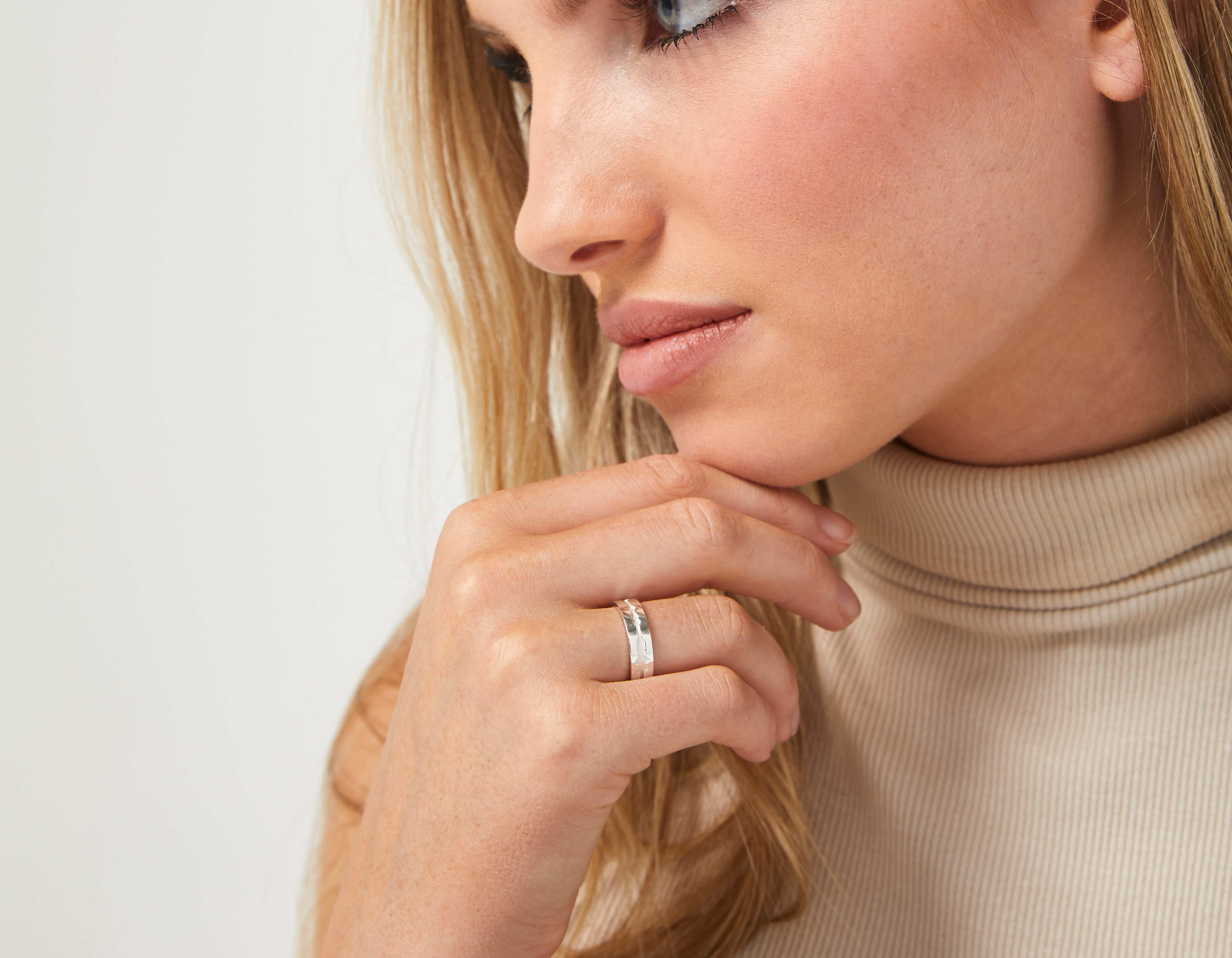 The Outer Wave Ring in Sterling Silver on a female
