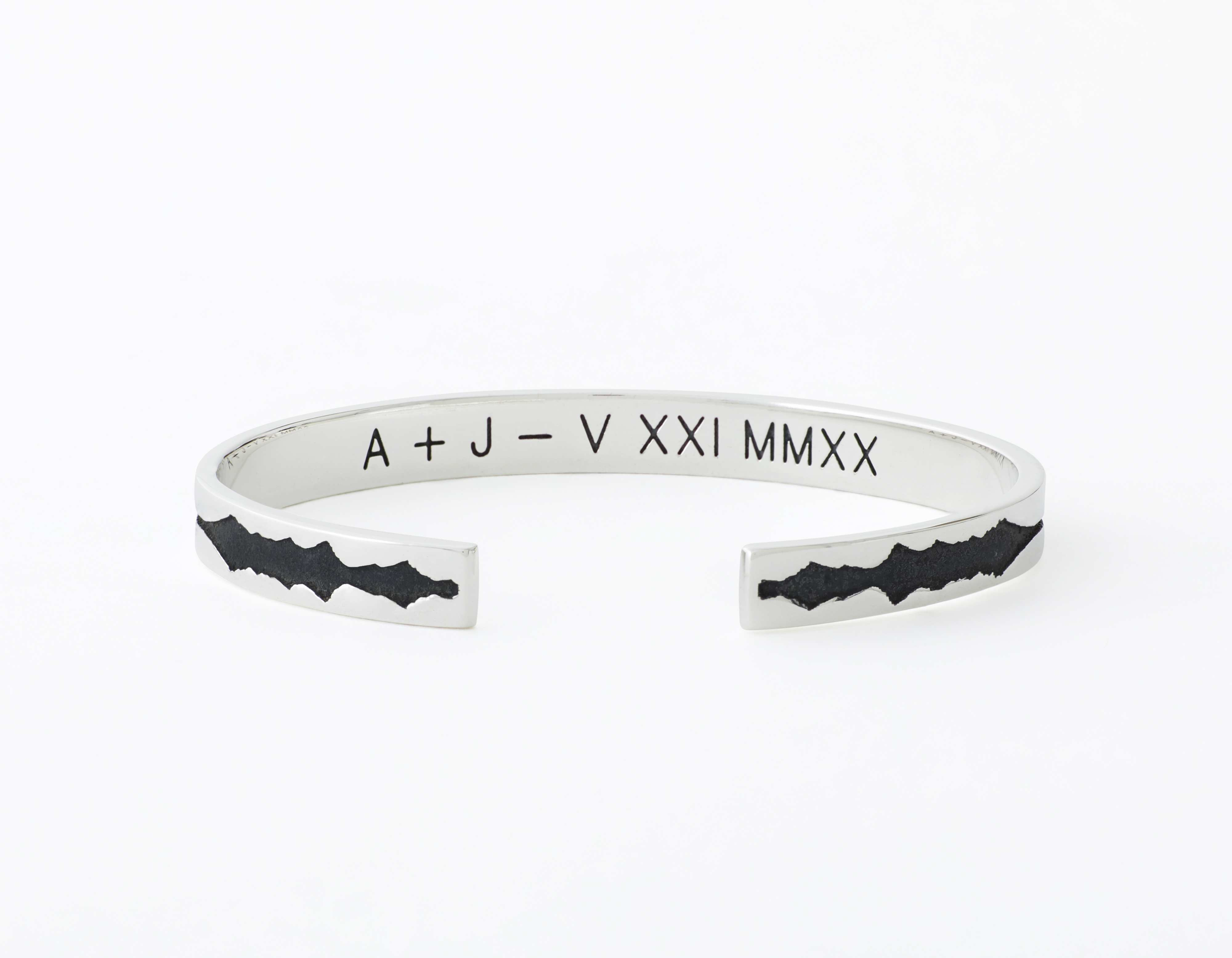 The Outer Wave Bracelet placed horizontal-inner in Antiqued Sterling Silver
