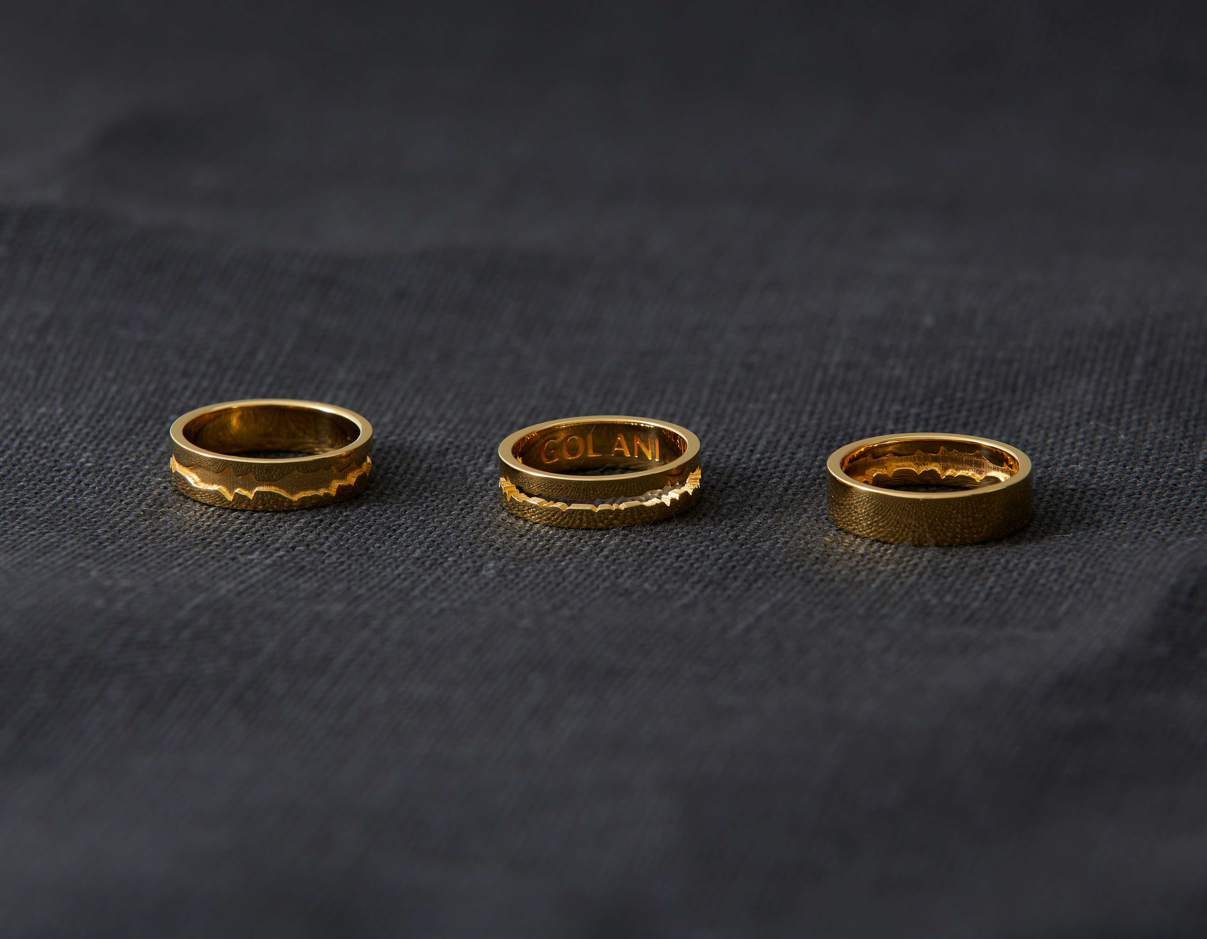 Golani wave ring collection in 14-karat gold.