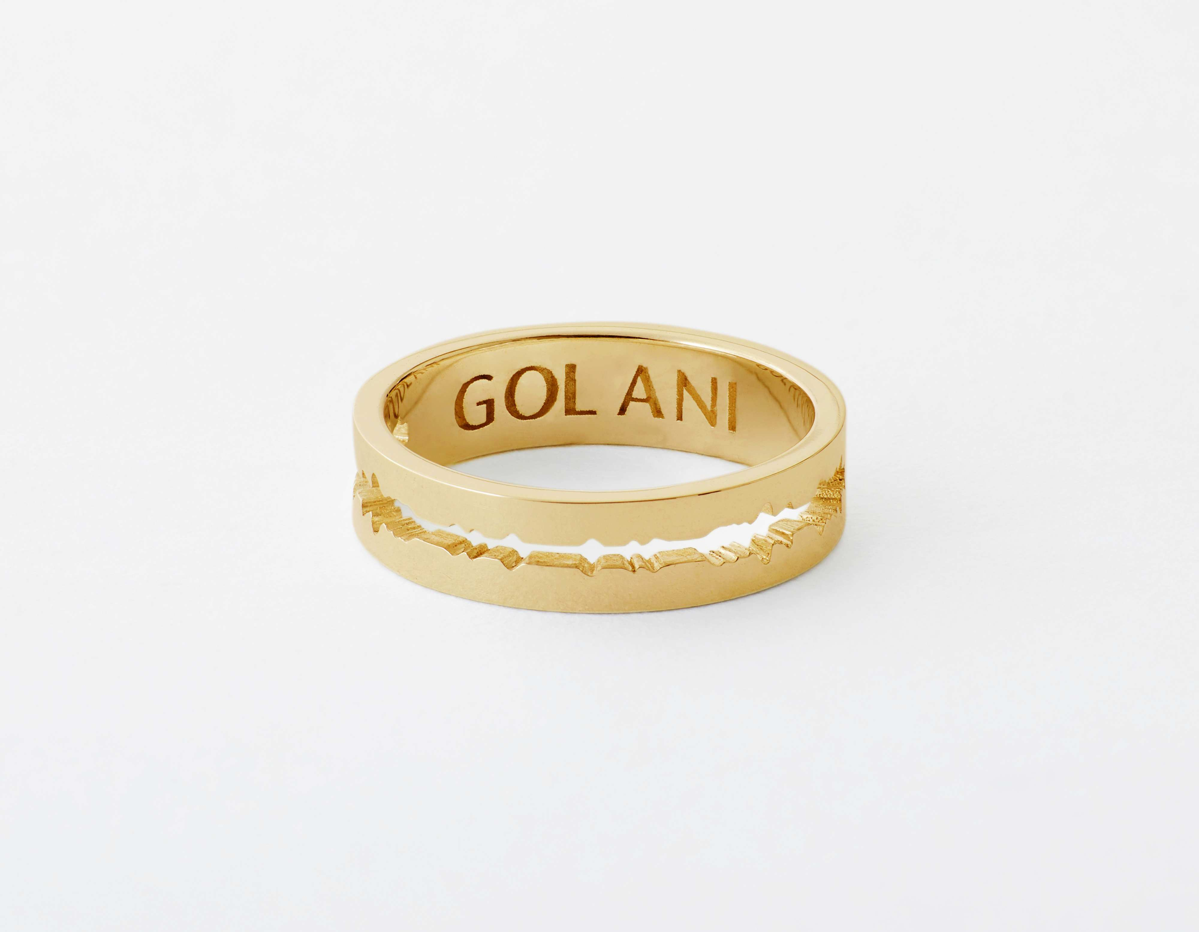 The Cut Wave Ring placed horizontal in 14-Karat Gold