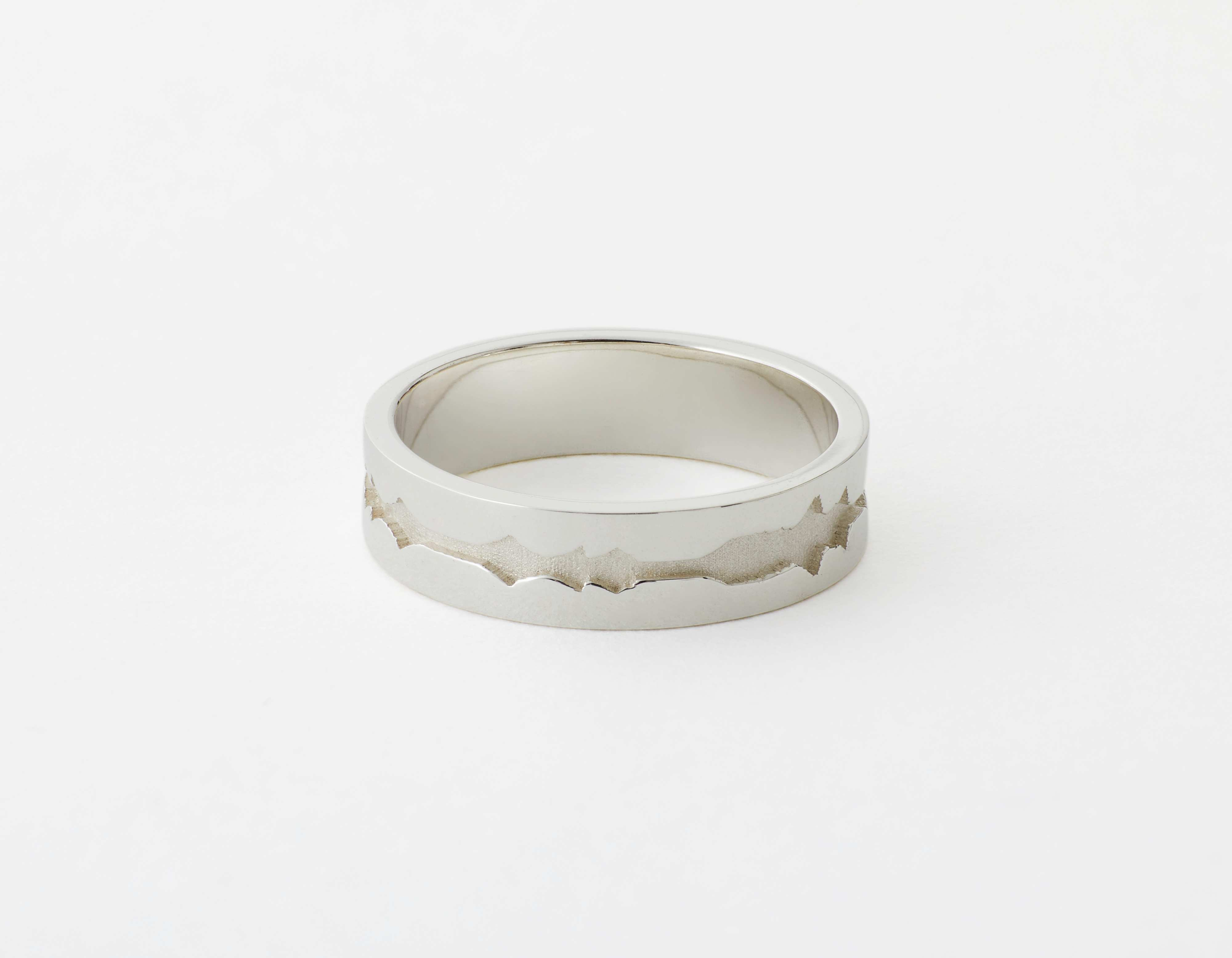 The Outer Wave Ring placed horizontal in Sterling Silver