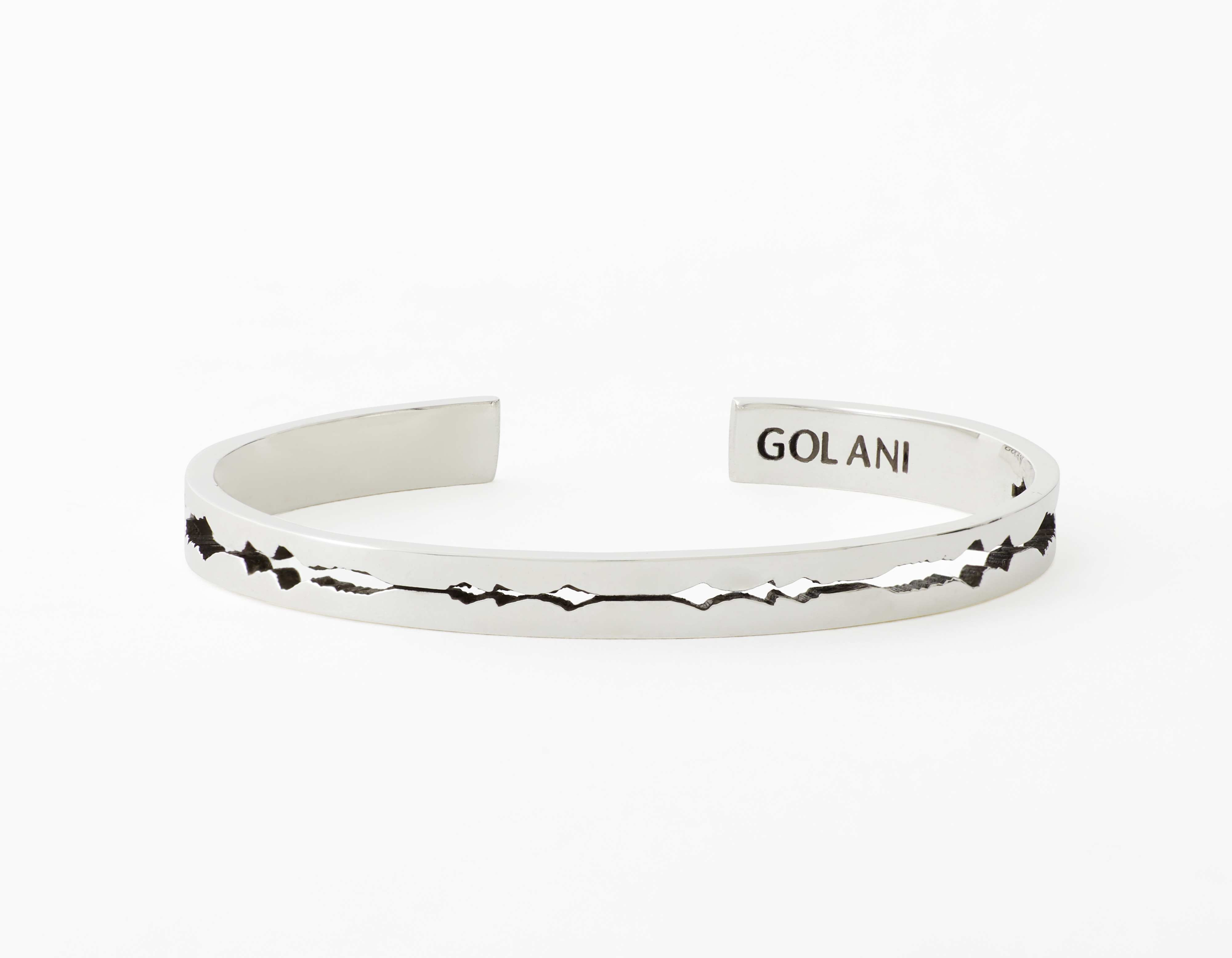 The Cut Wave Bracelet placed horizontal in Antiqued Sterling Silver