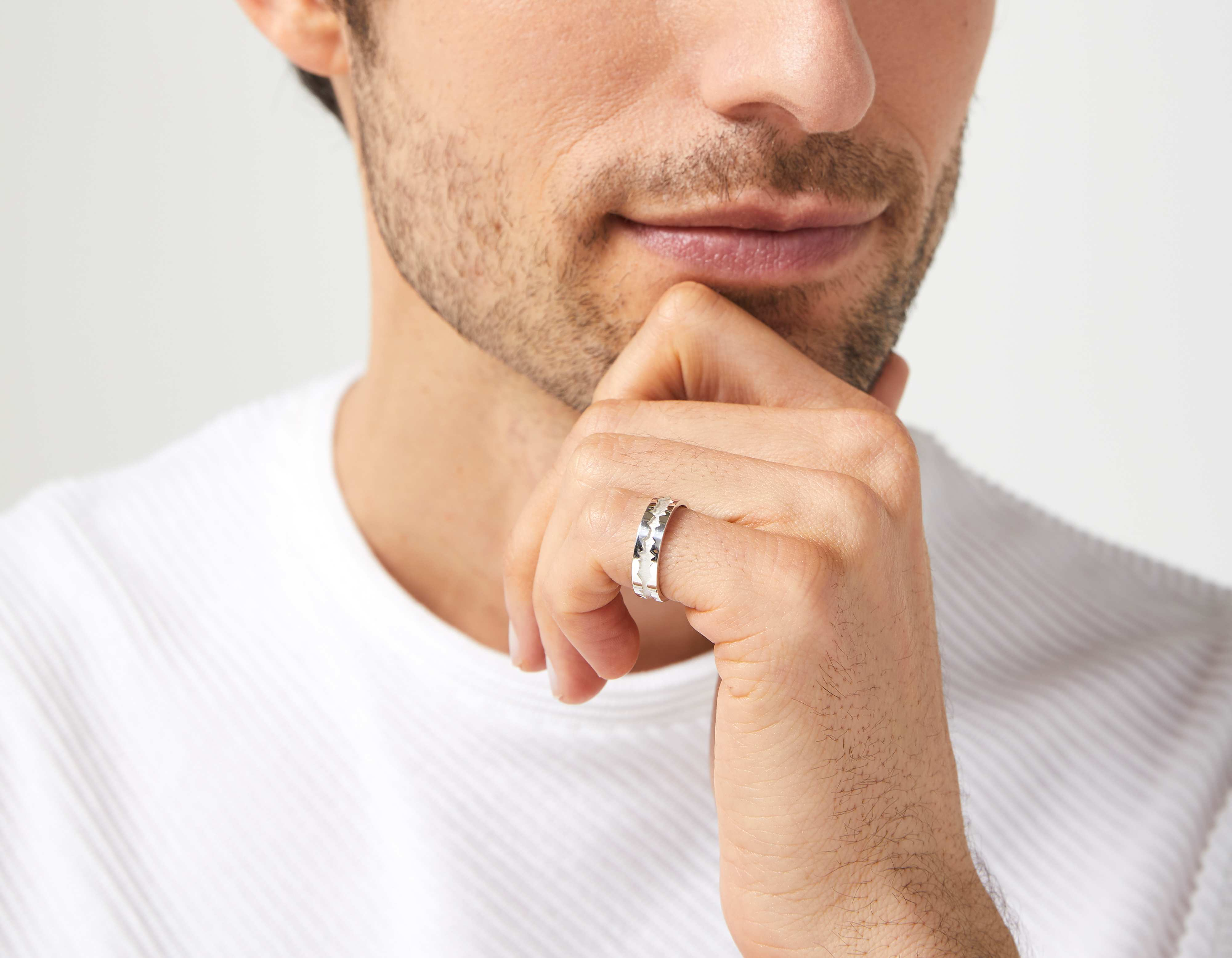 The Outer Wave Ring in Sterling Silver on a male