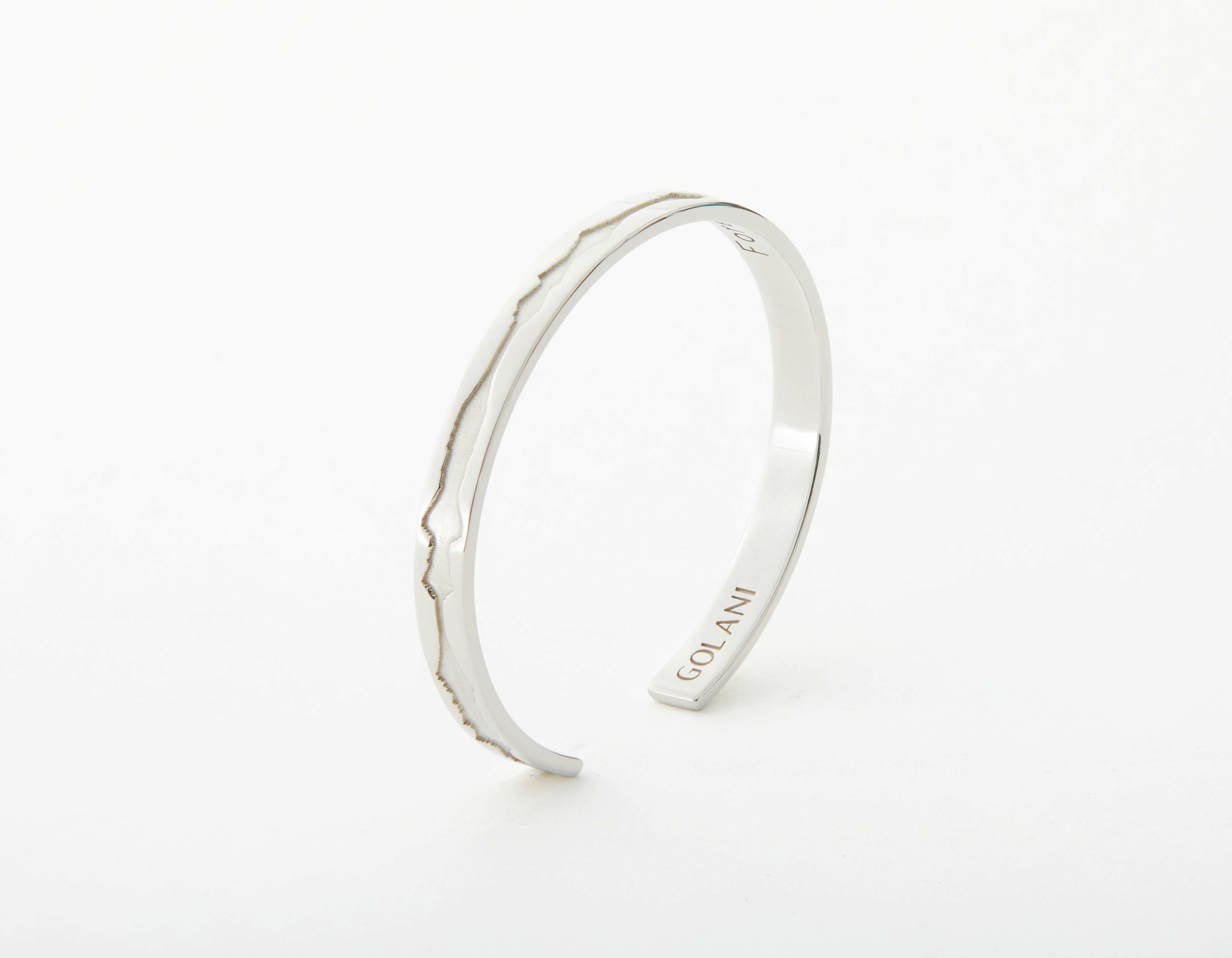 The Outer Wave Bracelet placed vertical in White Gold thumbnail