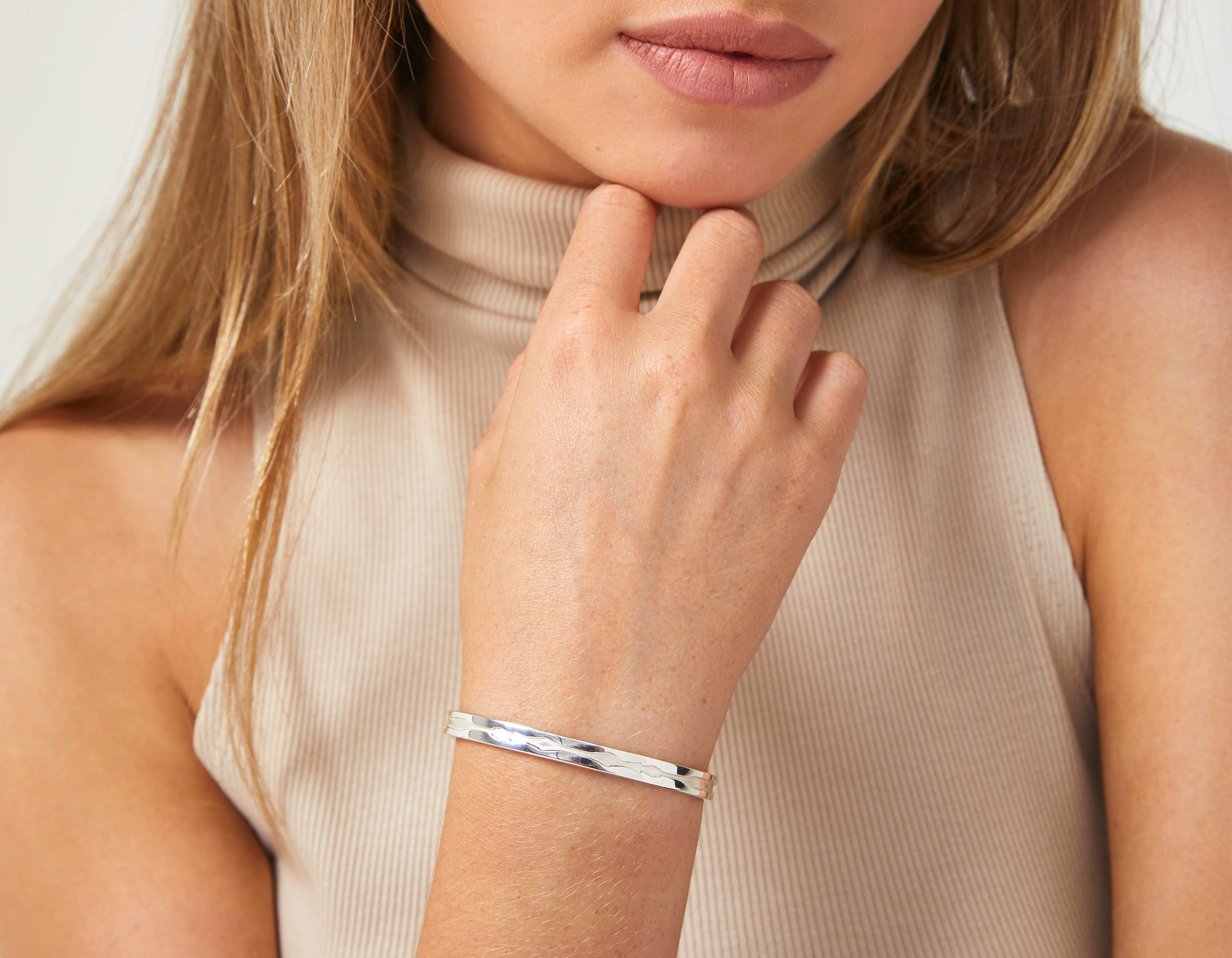 The Outer Wave Bracelet in White Gold on a female