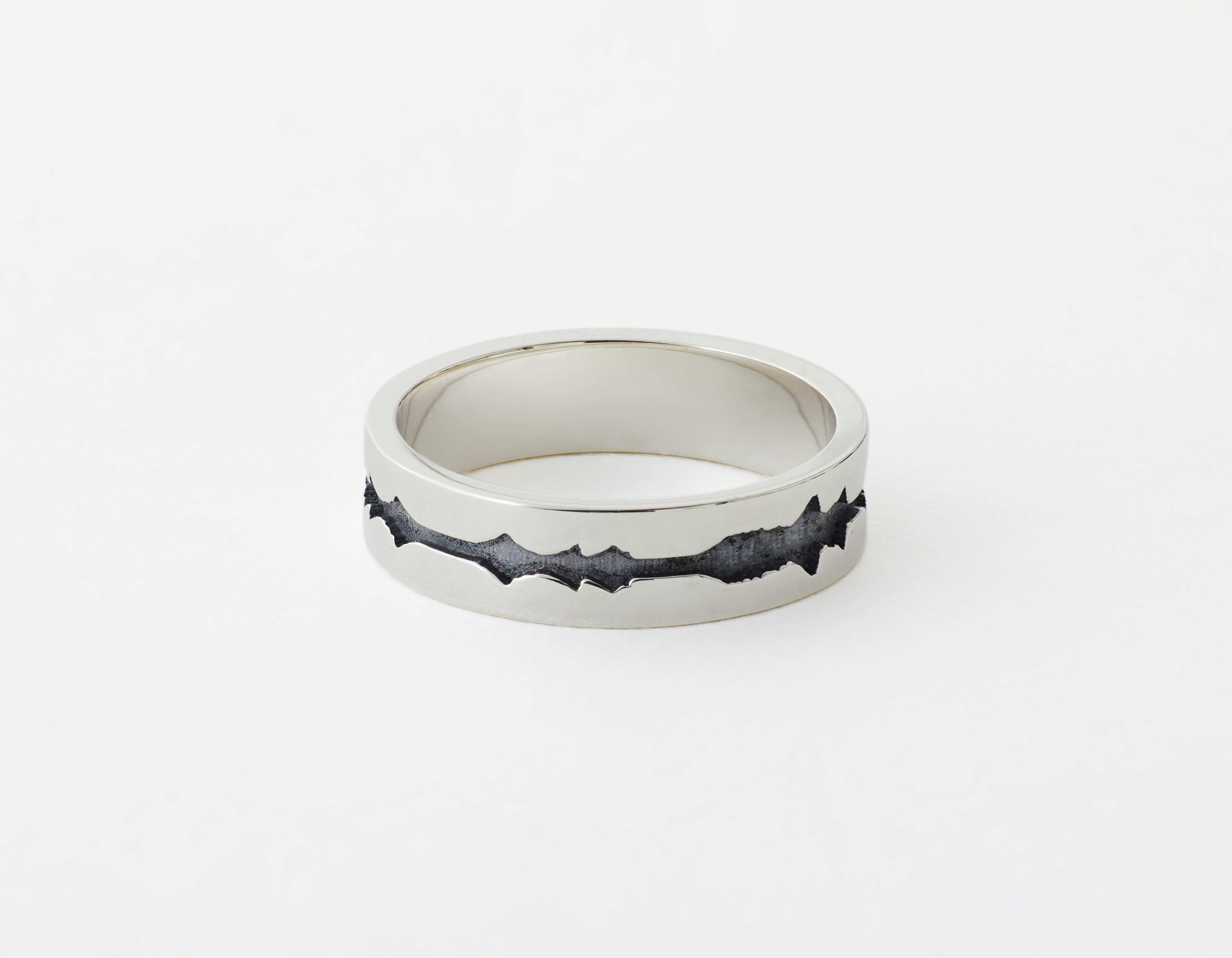 The Outer Wave Ring placed horizontal in Antiqued Sterling Silver