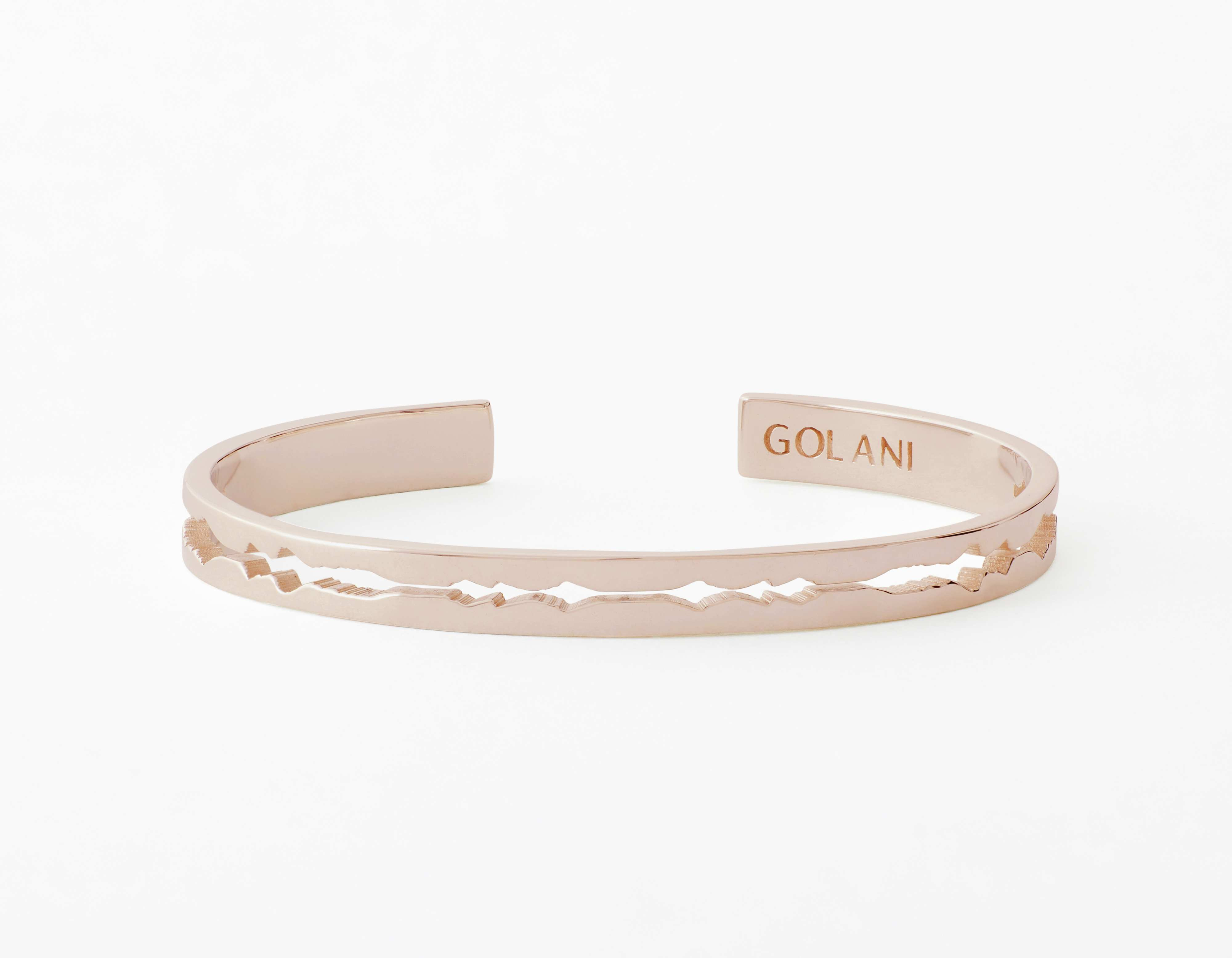 The Cut Wave Bracelet placed horizontal in Rose Gold