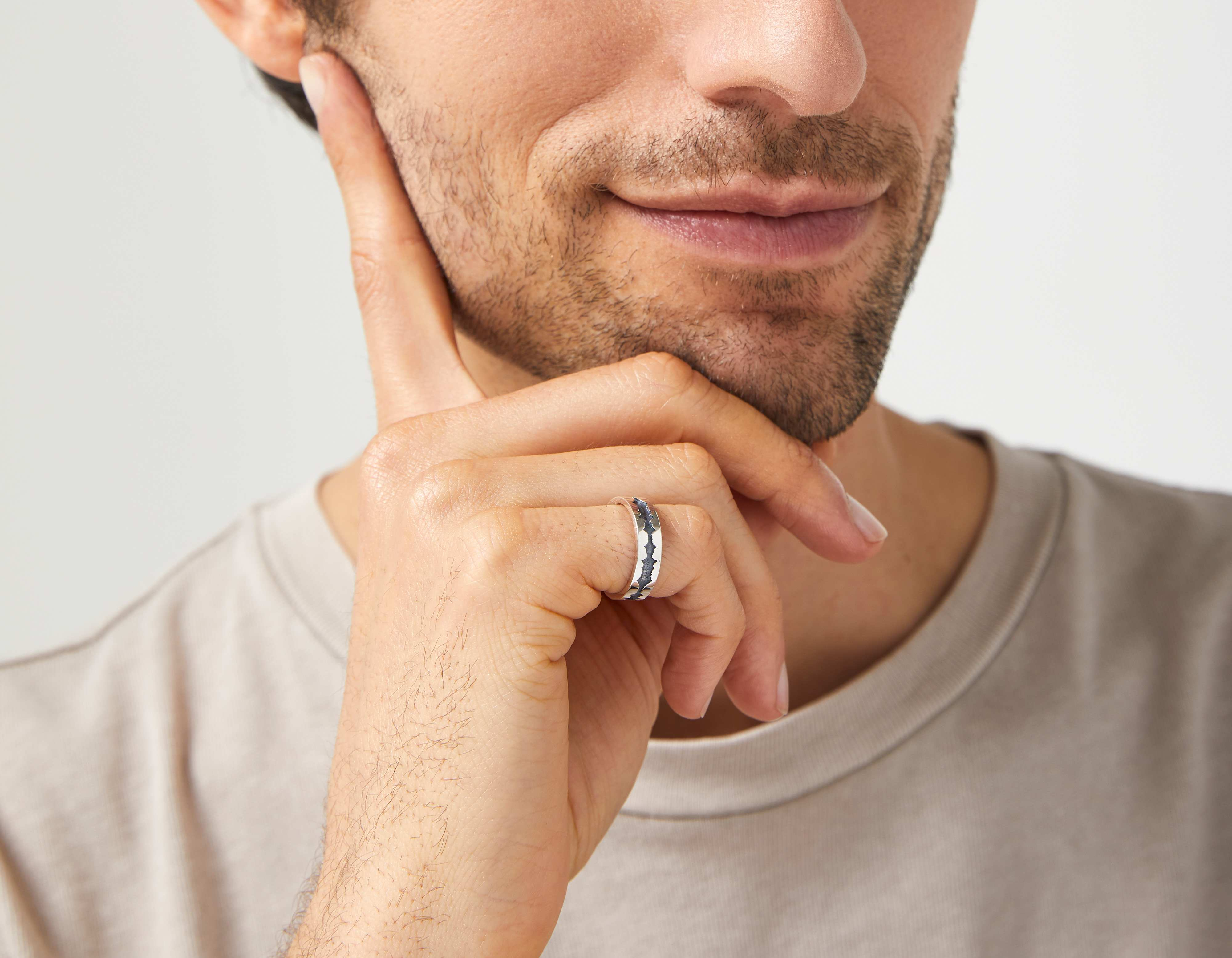 The Outer Wave Ring in Antiqued Sterling Silver on a male
