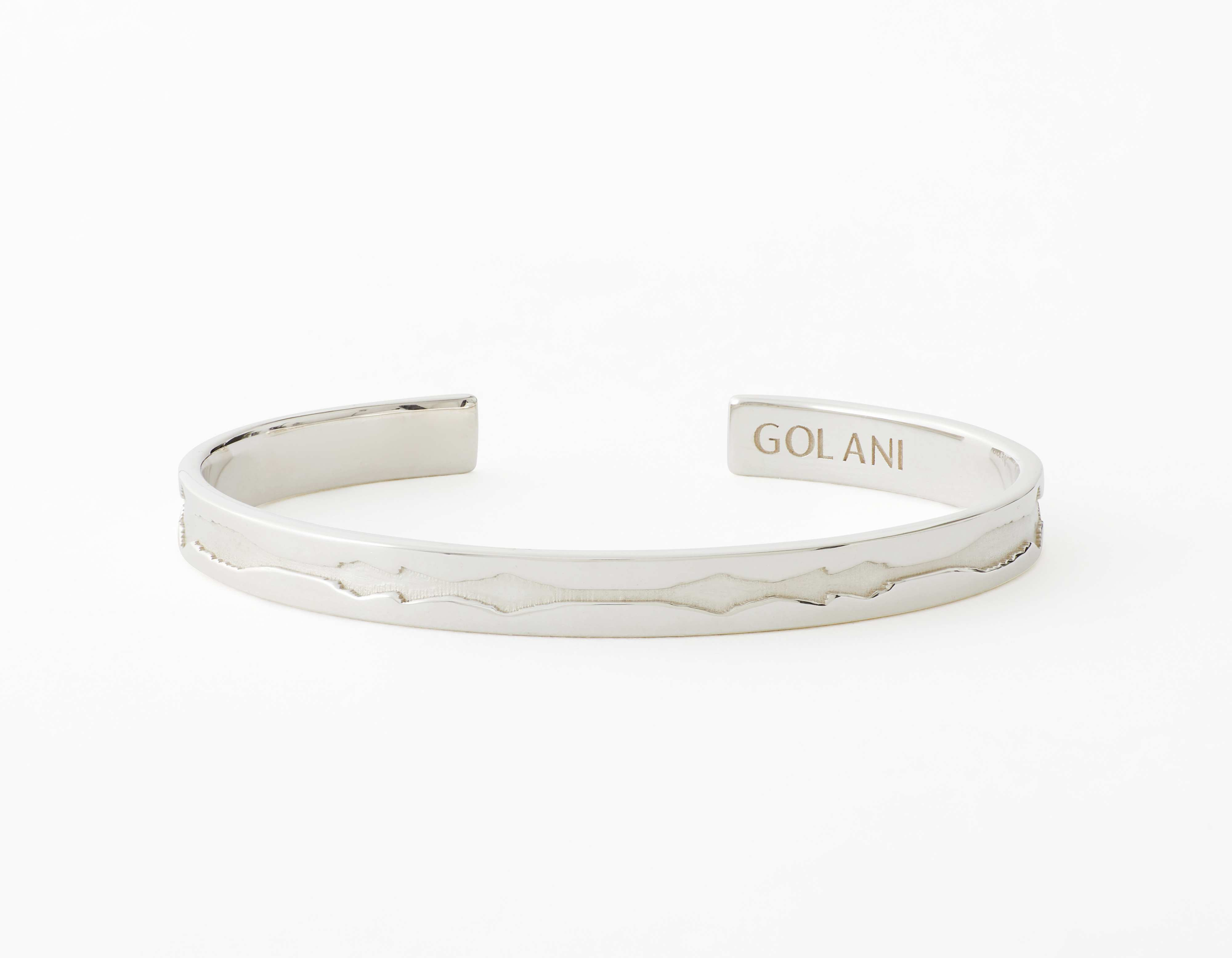 The Outer Wave Bracelet placed horizontal in White Gold