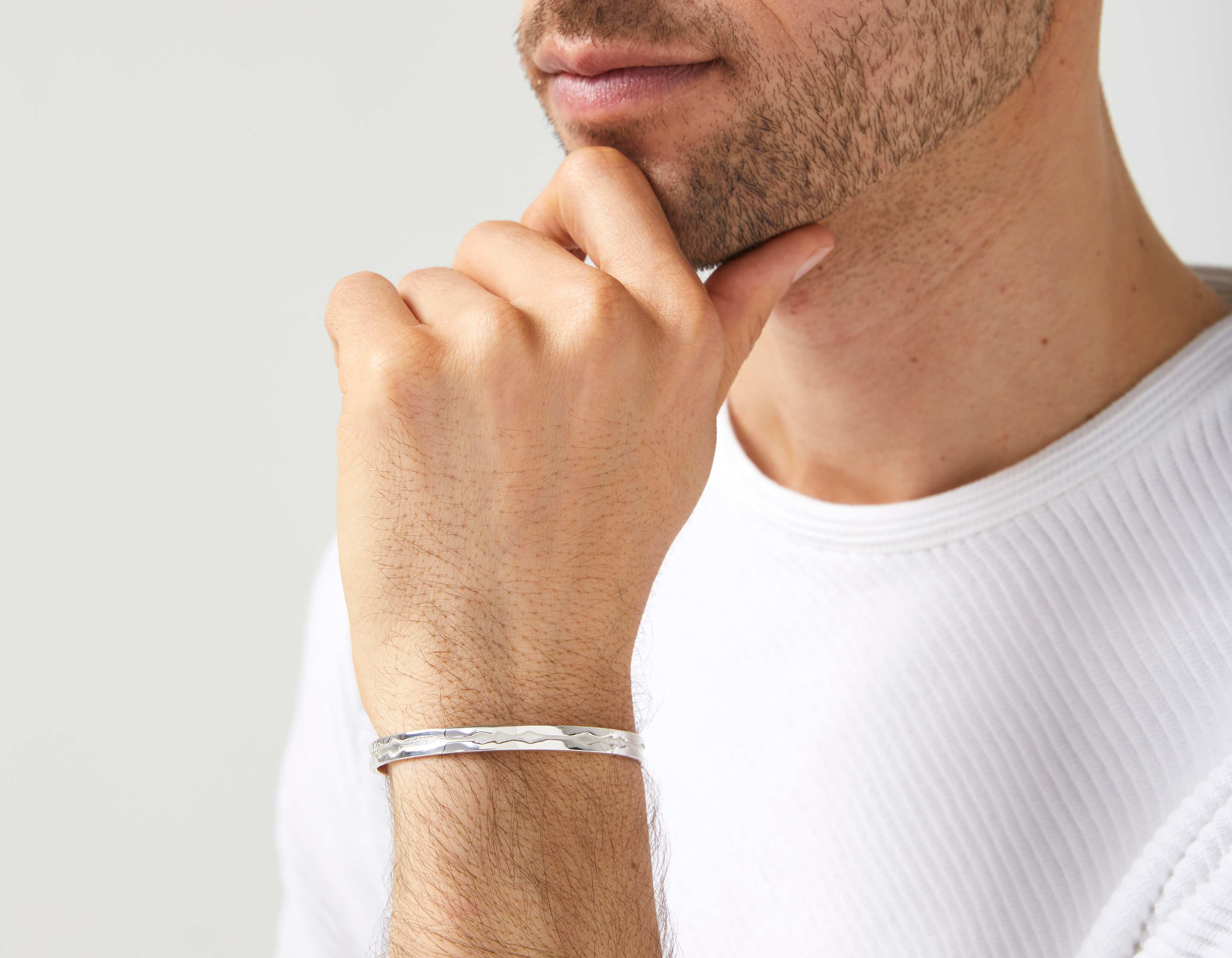 The Outer Wave Bracelet in White Gold on a male
